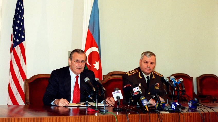 Secretary of Defense Donald H. Rumsfeld responds to a reporterÕs question during a joint press briefing with Minister of Defense Colonel General Safar Abiyev at the Presidential Palace in Baku, Azerbaijan, on Dec. 15, 2001.  Rumsfeld is meeting with leaders of the Caucasus region to establish military-to-military links with those countries.  DoD photo by Helene C. Stikkel.  (Released)