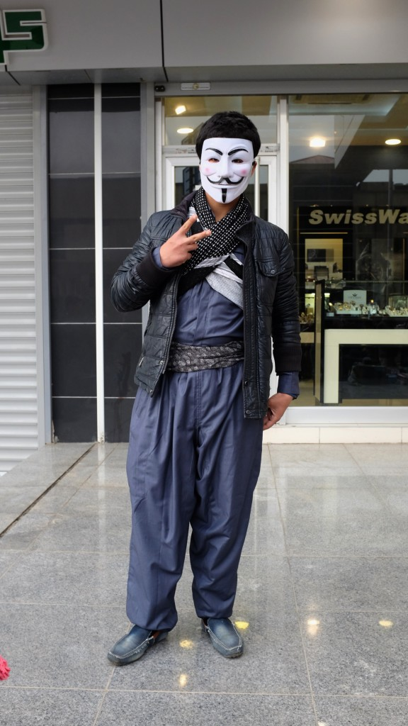 Others chose a more modern international symbol of resistance, a Guy Fawkes mask