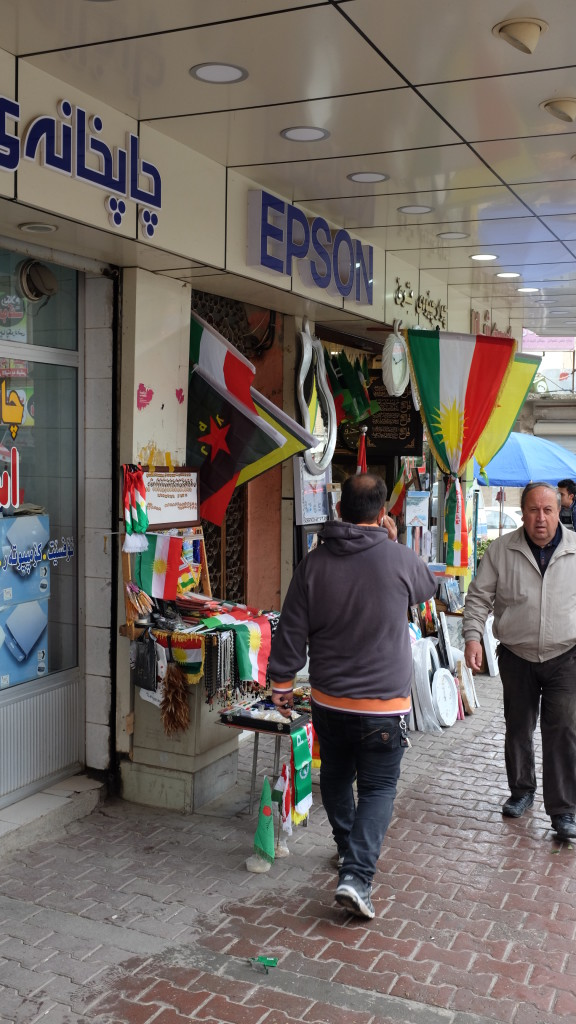 Shop keepers sold flags of various Kurdish armed groups.