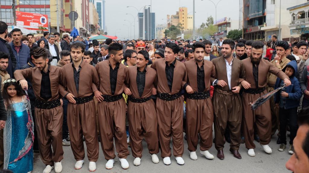 Men in traditional garb performing the traditional Kurdish dance, Hilperkê