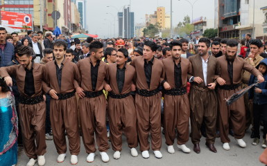 Men in traditional garb performing the traditional Kurdish dance, Hilperkê