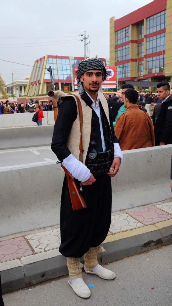 Many men dressed up in traditional attire